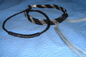 two necklaces with horsehair